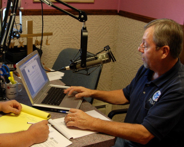 [Severe Storms, Flooding, and Tornadoes] Upper Sandusky, Ohio, September 5, 2007 -- Public information Officer (PIO) Tim Tyson checks his notes just before going on the air at WXML; a radio station located within the disaster area. FEMA works with and through local media outlets to help keep communities informed about available disaster help. Mike Moore/FEMA