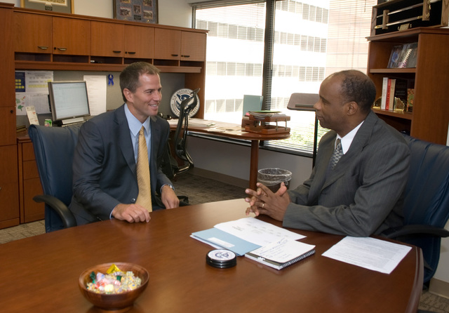 "Washington, DC, September 5, 2007 -- Matt Lawrence, a UPS logistics expert, talks to FEMA's William ""Eric"" Smith, Assistant Administrator, Logistics Management Directorate at FEMA headquarters. FEMA has developed the first-ever loaned executive program and is working through the U.S. Chamber of Commerce and the United Parcel Service's (UPS) Foundation to bring a seasoned UPS executive into the agency's newly formed Logistics Management Directorate to share private sector expertise. FEMA/Bill Koplitz"