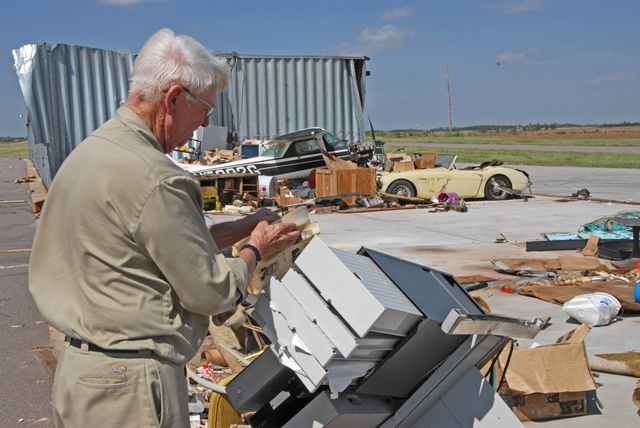 [Severe Storms, Tornadoes, and Flooding] Watonga, OK, September 6, 2007   -- Bob Oler, Watonga Airport Manager, salvages material from the debris pile created after a tornado hit the airport.  FEMA has Public Assistance programs available to help State and local governments recover costs from storm damages.  Marvin Nauman/FEMA photo