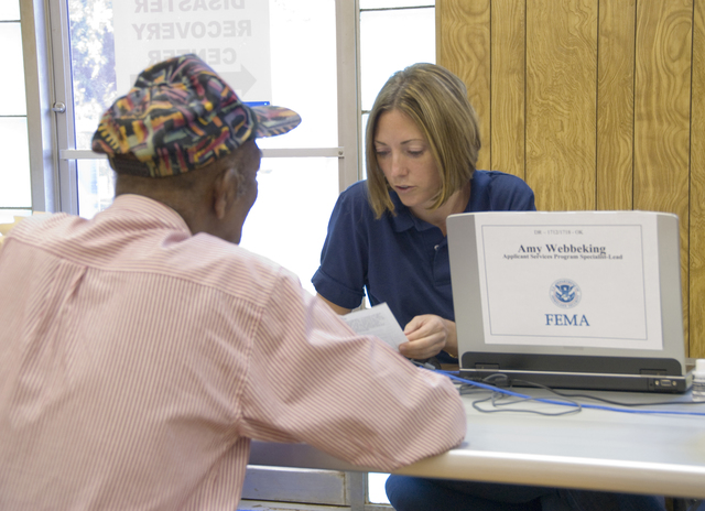 [Severe Storms, Tornadoes, and Flooding] Watonga, OK, September 6, 2007 -- Harry Holcomb meets with Amy Webbeking FEMA Individual Assistant Specialist to get help with his FEMA aid application at a FEMA Disaster Recovery Center (DRC).  DRC's provide applicants with information about FEMA aid and help filling out their application.  Marvin Nauman/FEMA