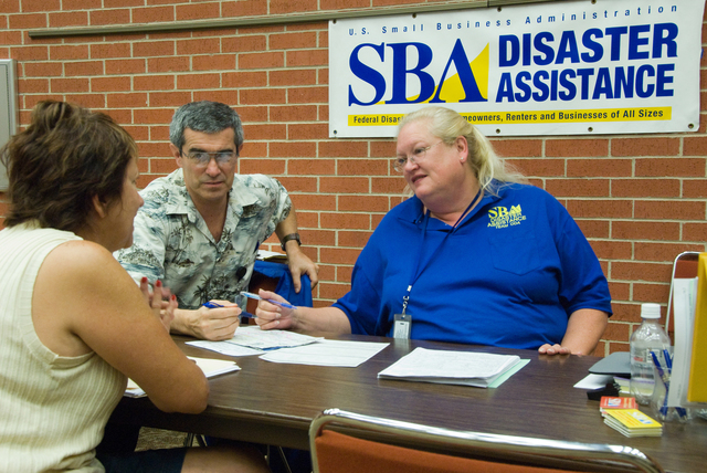 [Severe Storms, Tornadoes, and Flooding] El Reno, OK, September 28, 2007 -- Small Business Administration Specialist (SBA) Cynthia Cawell and William Stowell answers Billie Wilds questions at a FEMA Disaster Recovery Center about a business recovery loan for her damaged Sod farm and loss of business.  The Small Business Administration has low interest loans available to help Individuals and Business recover from disaster damages.  Marvin Nauman/FEMA photo