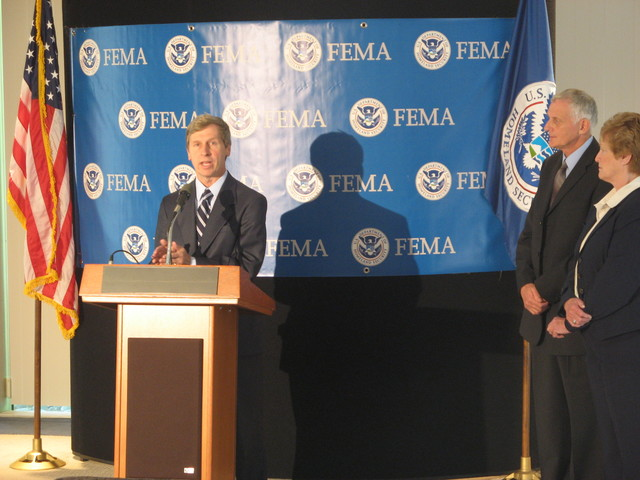 Boston, MA, October 9, 2007 -- New Hampshire Gov. John Lynch addresses a press conference following the first ever New England Regional Advisory Council meeting, as Region I Administrator Art Cleaves and Connecticut Gov. Jodi Rell look on.  FEMA Photo Darby Duffin