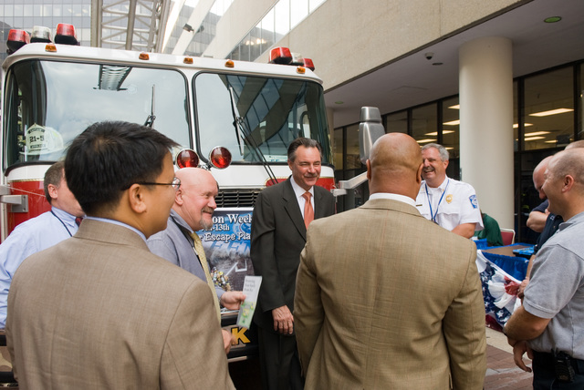 Washington, DC, October 9, 2007 -- FEMA Administrator David Paulison is surrounded by exhibitors and FEMA co-workers in front of a fire truck from Mt. Weather.  The truck is visiting FEMA headquarters to kick off Fire Prevention week.  FEMA/Bill Koplitz