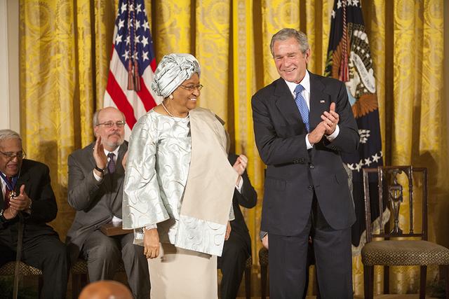 President George W. Bush Awards the Presidential Medal of Freedom to Liberian President Ellen Johnson Sirleaf in the East Room of the White House