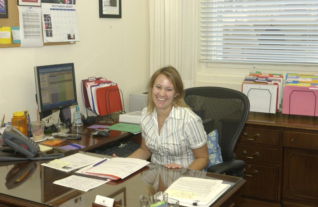 HUD Staff, Informal Portrait - Office of the Secretary staff member at desk--informal portrait