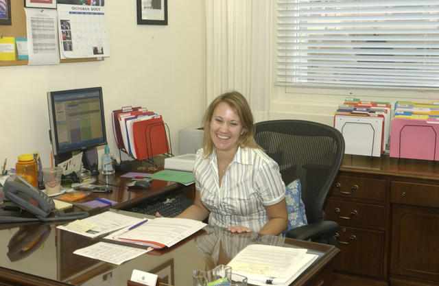 HUD Staff, Informal Portrait - Office of the Secretary staff member at desk--informal portrait