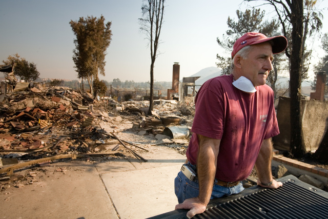 [Wildfires] Rancho Bernardo, CA, October 26, 2007 -- Long time friend of family, John Rossi, spends his day helping the Wagner family sift through their belongings following the devastating fire that destroyed their home. Andrea Booher/FEMA