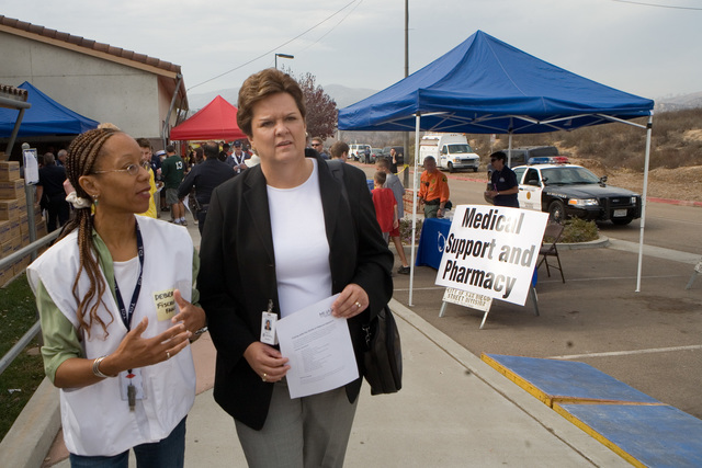 [Wildfires] Rancho Bernardo, CA, October 27, 2007 -- FEMA Region 9 Administrator, Nancy Ward, and Local Assistance Center Manager, tour center where fire impacted residents can get State and Federal disaster assistance following the devastating San Diego fires. Andrea Booher/FEMA