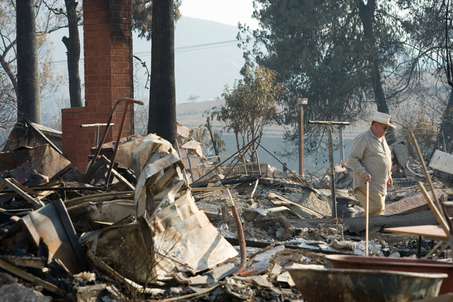 [Wildfires] Rancho Bernardo, CA, October 28, 2007 -- A family friend  helps search for belongings in this Rancho Bernardo home destroyed by the San Diego wildfires  Andrea Booher/FEMA