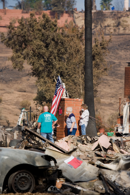 [Wildfires] Rancho Bernardo, CA, October 28, 2007 -- Residents return to their homes and search for possessions amongst the rubble left  by the San Diego wildfires. Andrea Booher/FEMA
