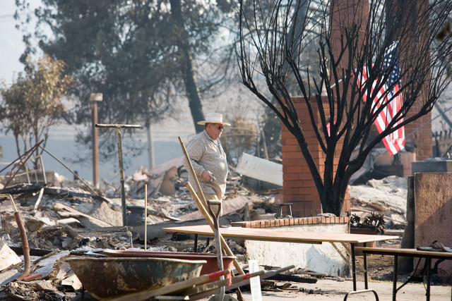 [Wildfires] Rancho Bernardo,CA, October 28, 2007 -- A friend of the family helps search for belongings in this Rancho Bernardo home destroyed by the San Diego wildfires. Andrea Booher/FEMA