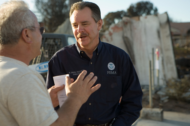 [Wildfires] Rancho Bernardo, CA, October 30, 2007 -- FEMA Director, Chief Paulison talks with Oscar Afshari, a Rancho Bernardo resident that lost his home in the recent Southern California fires.  Andrea Booher/FEMA