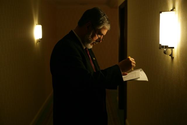 David Addington Reviewing a Document
