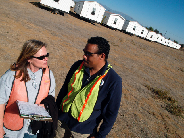 [Wildfires] March Air Force Base, CA, November 20, 2007 --  Deborah Maggard, FEMA deputy site manager for mobile home inspections and Anthony Johnson, a FEMA Individual Assistance liaison, review mobile home inspection criteria after inspecting the first mobile home slated for use in the wake of the wild fires in Southern California. Amanda Bicknell/FEMA