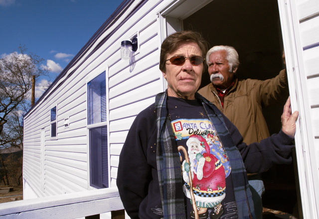 [Wildfires] Pauma Valley, CA, December 11, 2007 -- Vonda and Benjamin Rodriguez, of the La Jolla Tribe, who lost their home when the wildfires swept through the reservation in October, are now temporarily living in a FEMA-provided mobile home. The couple's new home is slated to be rebuilt next to the mobile home on the foundation of the home that was destroyed. Amanda Bicknell/FEMA