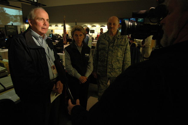 [Severe Storms, Flooding, Landslides, and Mudslides] Camp Murray, WA, December 15, 2007 - Thomas Davies (l), a FEMA Federal Coordinating Officer (FCO),  is interviewed with Washington State Governor Christine Gregoire, and Major General Timothy Lowenberg, adjutant general of Washington. Severe storms and flooding affected numerous counties in Washington. With a Federal Declaration FEMA responds with assistance to state and local governments. The aid will help individuals and local governments in the recovery efforts. Leif Skoogfors/FEMA