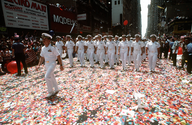 A Navy officer leads his unit along a confetti-covered street as they march in the city's victory parade for the returning veterans of Operation Desert Shield and Operation Desert Storm
