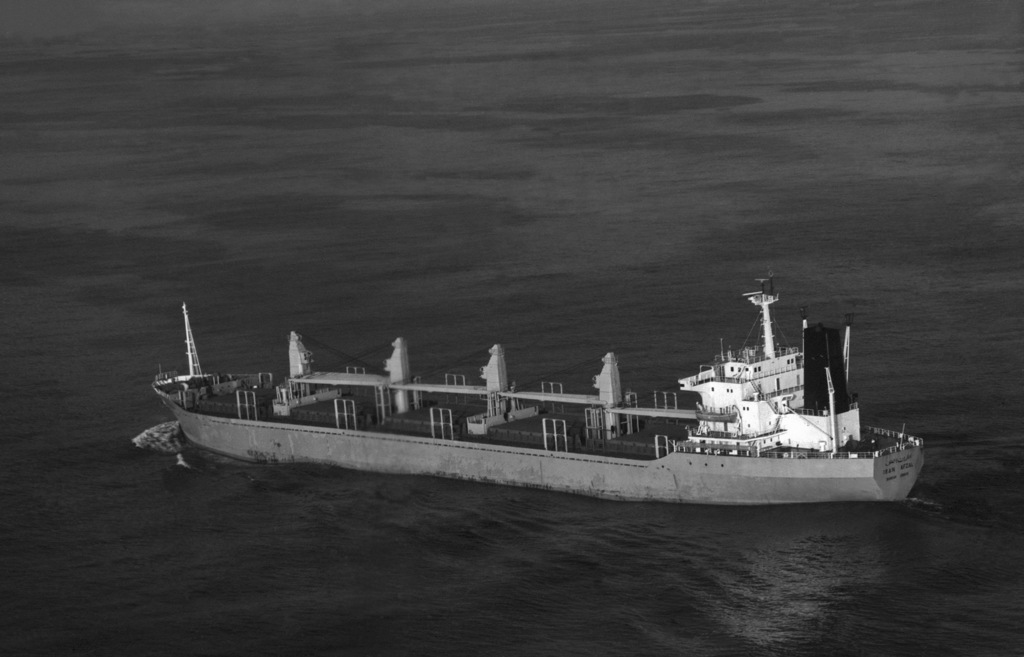 An aerial port quarter view of the merchant ship Iran Afzal underway. OFFICIAL U.S. NAVY PHOTO (RELEASED)