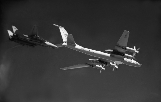An air-to-air right side view of an Indian Navy Soviet-made Tu-142 Bear F reconnaissance aircraft, right, and a U.S. Navy F-14A Tomcat from Fighter Squadron 114 (VF-114), left. OFFICIAL U.S. NAVY PHOTO (RELEASED)