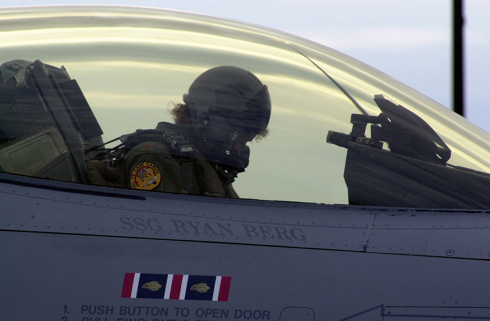 An F-16 Pilot with the 179th Fighter Squadron, 148th Fighter Wing, Duluth International Airport, takes a final moment to mentally prepare for the extreme possibility of having to shoot down a passenger aircraft during the upcoming CAP (Combat Air Patrol) assignment. The order issued from NORAD on September 12, 2001 as part of Operation NOBLE EAGLE, after the terrorist attacks on the day before at the World Trade Center and the Pentagon. The terrorist hijacked four passenger aircraft and used them as suicide weapons killing thousands on the ground. The Wing flew numerous air sovereignty missions over North American cities in support of the FAA's, first ever, total restriction of ...