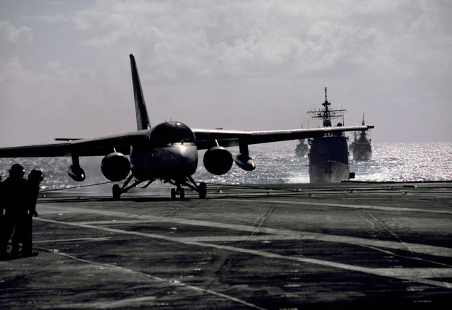 An S-3A Viking aircraft touches down on the flight deck of an aircraft carrier after taking part in an anti-submarine warfare support operation. OFFICIAL U.S. NAVY PHOTO (RELEASED)