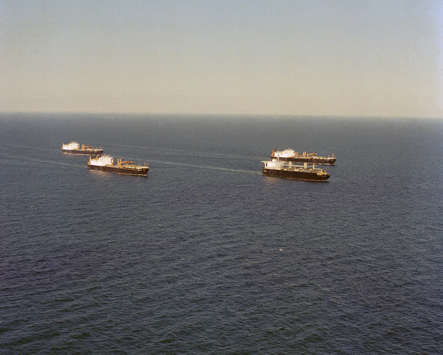 Atlantic Ocean....An aerial view of Maritime Pre-positioning Ship Squadron 1 underway. The squadron is composed of: 2nd LT. John P. Bobo (T-AK- 3007), foreground, SGT. Matej Kocak (T-AK-3004), PFC. Eugene A. Obregon (T-AK-3005) and MAJ. Stephen W. Pless (T-AK-3006). OFFICIAL U.S. NAVY PHOTO (RELEASED)