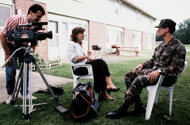 Christine DeFraco, Channel 5, WPTZ, interviews TECH. SGT. John DeLorenzo, Detachment 210, 2752nd Training Squadron. DeLorenzo is instrumental in organizing a video postcard project by which family and friends can send taped messages to military personnel deployed to Saudi Arabia in support of Operation Desert Shield