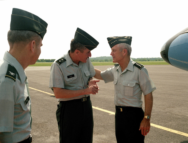 General John A Wickham Jr., Army CHIEF of STAFF, talks to Major General Frederic J. Brown, Commanding General, US Army Armor Center, after arriving for a visit