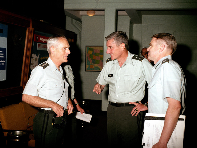 General John A. Wickham Jr., left, Army CHIEF of STAFF, talks with Major General Frederic J. Brown, center, Commanding General, US Army Armor Center, before appearing in an audio-visual production during his visit to Fort Knox