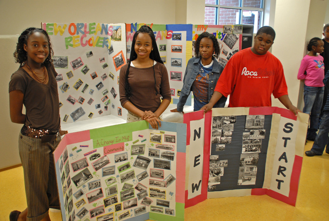 """[Hurricane Katrina] New Orleans, LA 1-21-06  Mannisha Henderson, Tatyana Franklin, Tawanee Green, and Derick Lyles show their posters on how they would like their community rebuilt.  FEMA is assisting the Louisiana Recovery Authority """"Collecting the Voices"""" of Orleans  Parash residents reguarding Long Term Recovery.  """"Louisiana Recovery Planning Day"""" at 19 Parashes and 11 Cities is an important part of FEMA's Long Term Community Recovery (LTCR) effort, which is being coordinated though the LRA and LTCR partners.  MARVIN NAUMAN/FEMA photo"""