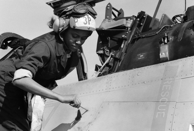 JO3 Cyndi Reilly Naval Air Station, Lemoore, Calif....AIRMAN Ora Howard, plane captain, performs a routine maintenance inspection on an A-7 Corsair II aircraft. OFFICIAL U.S. NAVY PHOTO (RELEASED)