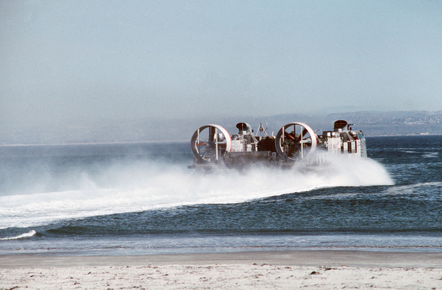 JOCS Theresa L. Dunn/PH1 Paul Pappas Naval Air Station, North Island, Calif....The air cushion landing craft LCAC-13 moves at speed into the surf during an amphibious warfare demonstration at Breakers Beach. OFFICIAL U.S. NAVY PHOTO (RELEASED)