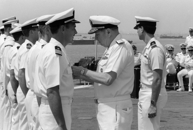 JOSN Andrew Marsh Persian Gulf....Adm. William J. Crowe, chairman, Joint Chiefs of STAFF, presents a medal to an officer during a ceremony held in conjunction with a press conference aboard the miscellaneous command ship USS Coronado (AGF-11). OFFICIAL U.S. NAVY PHOTO (RELEASED)