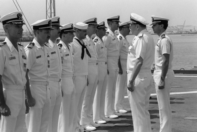 JOSN Andrew Marsh Persian Gulf....Adm. William J. Crowe, chairman, Joint Chiefs of STAFF, congratulates award recipients during a ceremony held in conjunction with a press conference aboard the miscellaneous command ship USS Coronado (AGF-11). OFFICIAL U.S. NAVY PHOTO (RELEASED)