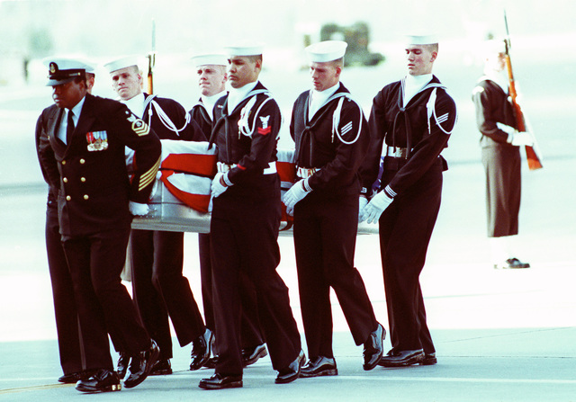 JOSN Oscar Sosa Dover Air Force Base, Del....Navy pallbearers carry the remains of one of the 47 crew members killed in an explosion aboard the battleship USS Iowa (BB-61). The explosion occurred in the No. 2 16-inch gun turret as the Iowa was conducting routine gunnery exercises approximately 300 miles northeast of Puerto Rico on April 19th. OFFICIAL U.S. NAVY PHOTO (RELEASED)