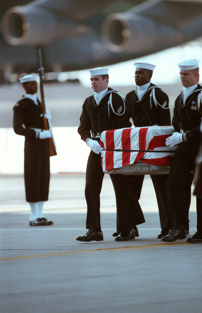 JOSN Oscar Sosa Dover Air Force Base, Del....Pallbearers carry the flag-draped casket of one of the 47 sailors who died when an explosion ripped through the No. 2 16-inch gun turret of the battleship USS Iowa (BB-61). OFFICIAL U.S. NAVY PHOTO (RELEASED)