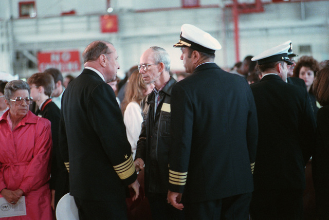 JOSN Oscar Sosa Norfolk, Va....Adm. William J. Crowe Jr., chairman, Joint Chiefs of STAFF, and CAPT. Fred. P Moosally, commanding officer of the battleship USS Iowa (BB-61), speak with the father of one of the 47 crew members killed in an explosion aboard the ship. The explosion occurred in the No. 2 16-inch gun turret as the Iowa was conducting routine gunnery exercises approximately 300 miles northeast of Puerto Rico on April 19th. OFFICIAL U.S. NAVY PHOTO (RELEASED)