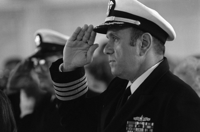 JOSN Oscar Sosa Norfolk, Va....CAPT. Fred P. Moosally, commanding officer of the battleship USS Iowa (BB-61), salutes as the national anthem is played during the memorial service for the 47 crew members killed in an explosion aboard the ship. The explosion occurred in the No. 2 16-inch gun turret as the Iowa was conducting routine gunnery exercises approximately 300 miles northeast of Puerto Rico on April 19th. OFFICIAL U.S. NAVY PHOTO (RELEASED)