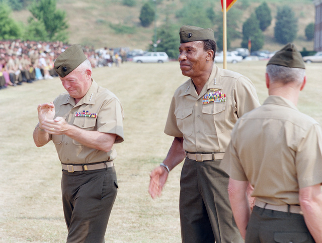 Lance CPL. E. Hanson Quantico, Va....GEN. Alfred M. Gray, Marine Corps commandant, left, LT. GEN. Frank E. Petersen, center, and LT. GEN. William R. Etnyre at the change of command ceremony in which Petersen retires. Of the two parts into which Petersen's