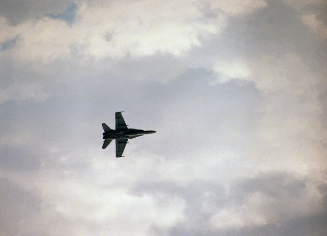 Lance CPL. E.S. Hansen Quantico, Va....An F/A-18 Hornet aircraft performs a fly-over during Airshow '88. OFFICIAL U.S. MARINE CORPS PHOTO (RELEASED)