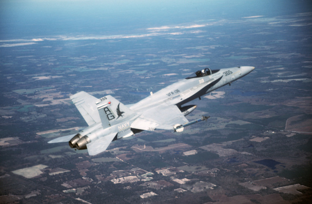LT. CMDR. John Leenhouts Florida....An air-to-air right side view of a Strike Fighter Squadron 136 (VFA-136) F/A-18A Hornet aircraft. The aircraft is armed with an AIM-9 Sidewinder missile on the right wing tip. OFFICIAL U.S. NAVY PHOTO (RELEASED)