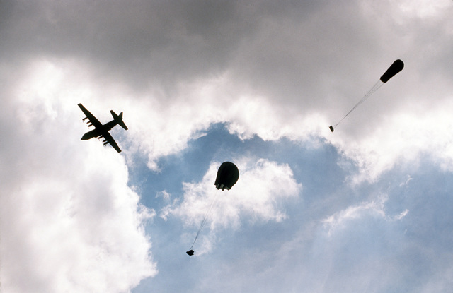 MASTER SGT. Dave Casey Puerto Rico....A 14th Air Force C-130 Hercules aircraft airdrops supplies for an assault force at Camp Santiago during exercise Patriot Pearl. OFFICIAL U.S. AIR FORCE PHOTO (RELEASED)