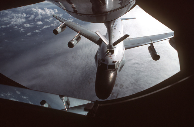 MASTER SGT. Patrick Nugent ....A KC-135R Stratotanker aircraft from the 912th Aerial Refueling Squadron refuels an RC-135 Stratolifter aircraft from the 306th Strategic Wing during a training mission over the North Sea. OFFICIAL U.S. AIR FORCE PHOTO (RELE