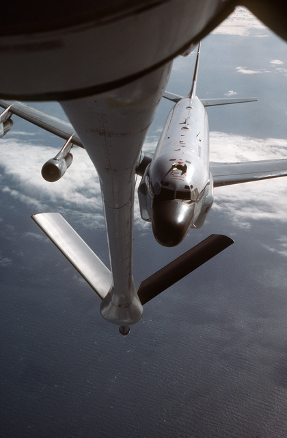 MASTER SGT. Patrick Nugent ....A KC-135R Stratotanker aircraft from the 912th Aerial Refueling Squadron prepares to refuel an RC-135 Stratolifter aircraft from the 306th Strategic Wing during a training mission over the North Sea. OFFICIAL U.S. AIR FORCE