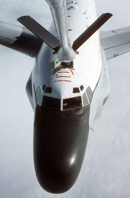 MASTER SGT. Patrick Nugent ....An RC-135 Stratolifter aircraft from the 306th Strategic Wing is refueled by a KC-135R Stratotanker aircraft from the 912th Aerial Refueling Squadron during a training mission over the North Sea. OFFICIAL U.S. AIR FORCE PHOT