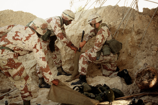 Members of the 24th Infantry Division fill sandbags at a defensive position during Operation Desert Shield