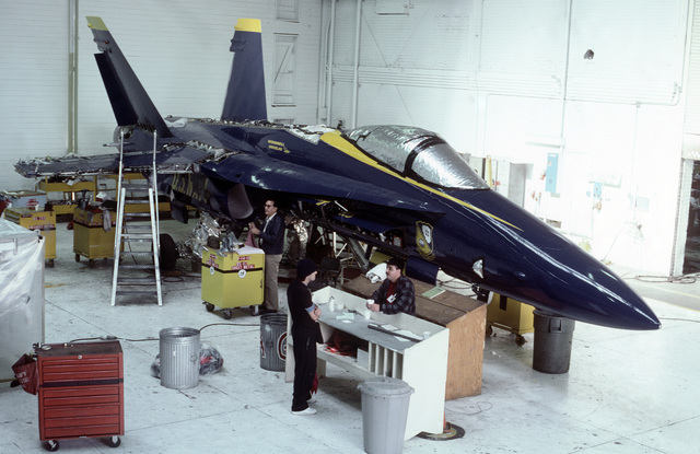 Pensacola, Fla....An F/A-18 Hornet aircraft is in the hangar being painted in the Blue Angel flight demonstration team paint scheme. OFFICIAL U.S. NAVY PHOTO (RELEASED)