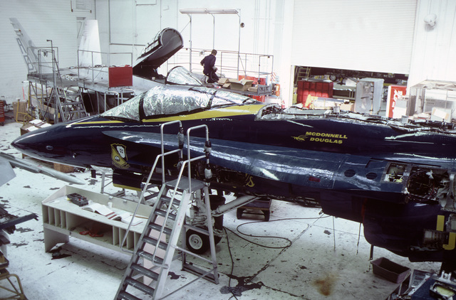 Pensacola, Fla....F/A-18 Hornet aircraft are in the hangar being painted in the Blue Angel flight demonstration team paint scheme. OFFICIAL U.S. NAVY PHOTO (RELEASED)