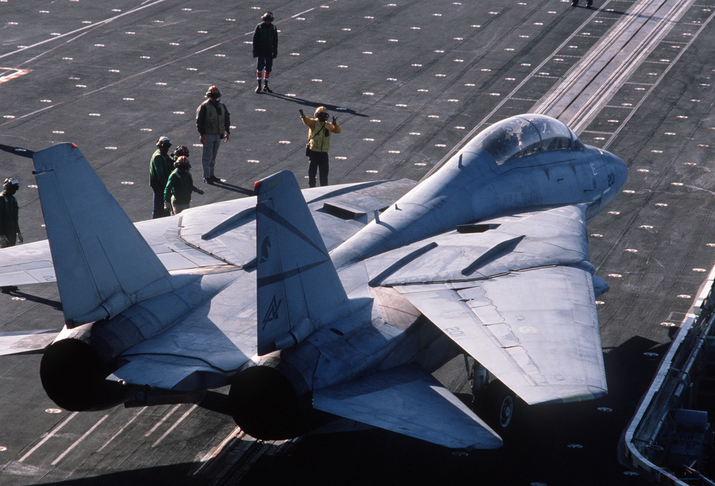 PH1 Anthony J. Kmiecik Pacific Ocean....A plane director signals to an F-14A Tomcat aircraft at the catapult on the deck of the USS Independence (CV-62) during carrier qualifications of Reserve Carrier Air Wing 30 (CVWR-30) off the coast of southern California. OFFICIAL U.S. NAVY PHOTO (RELEASED)