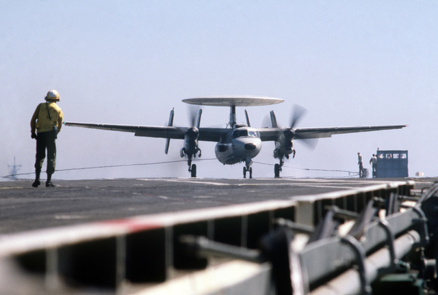 PH1 Anthony J. Kmiecik Pacific Ocean....An E-2C Hawkeye aircraft touches down on the deck of the USS Independence (CV-62) during carrier qualifications of Reserve Carrier Air Wing 30 (CVWR-30) off the coast of southern California. Fourth in a series of 5. OFFICIAL U.S. NAVY PHOTO (RELEASED)